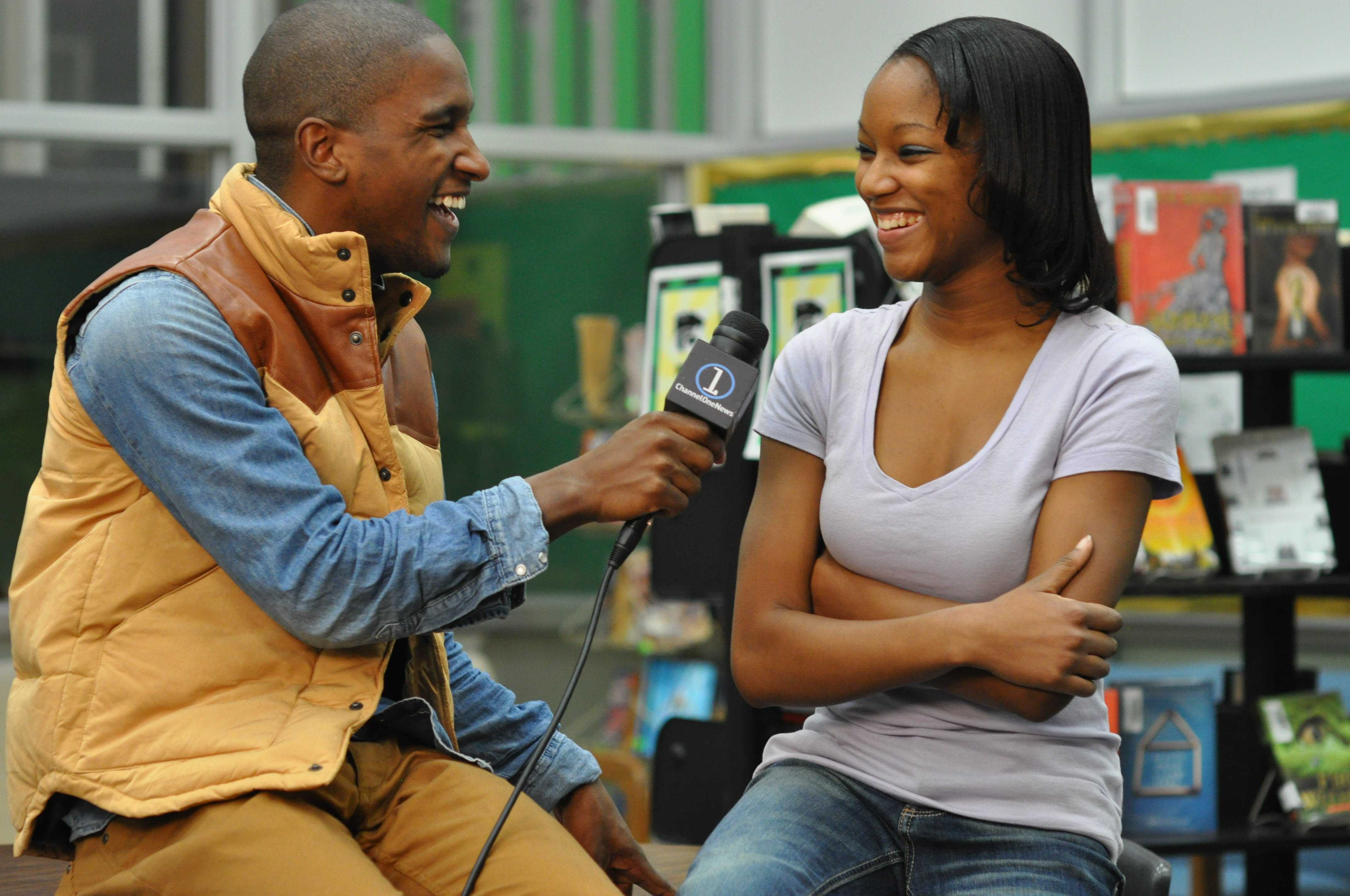 Tyeisha Conwell, sr., laughs along with Scott Evans during her interview.