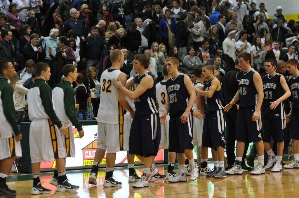 Kennedy and Xavier players tell each other good game after the Cougars defeated the Saints 59 to 45.