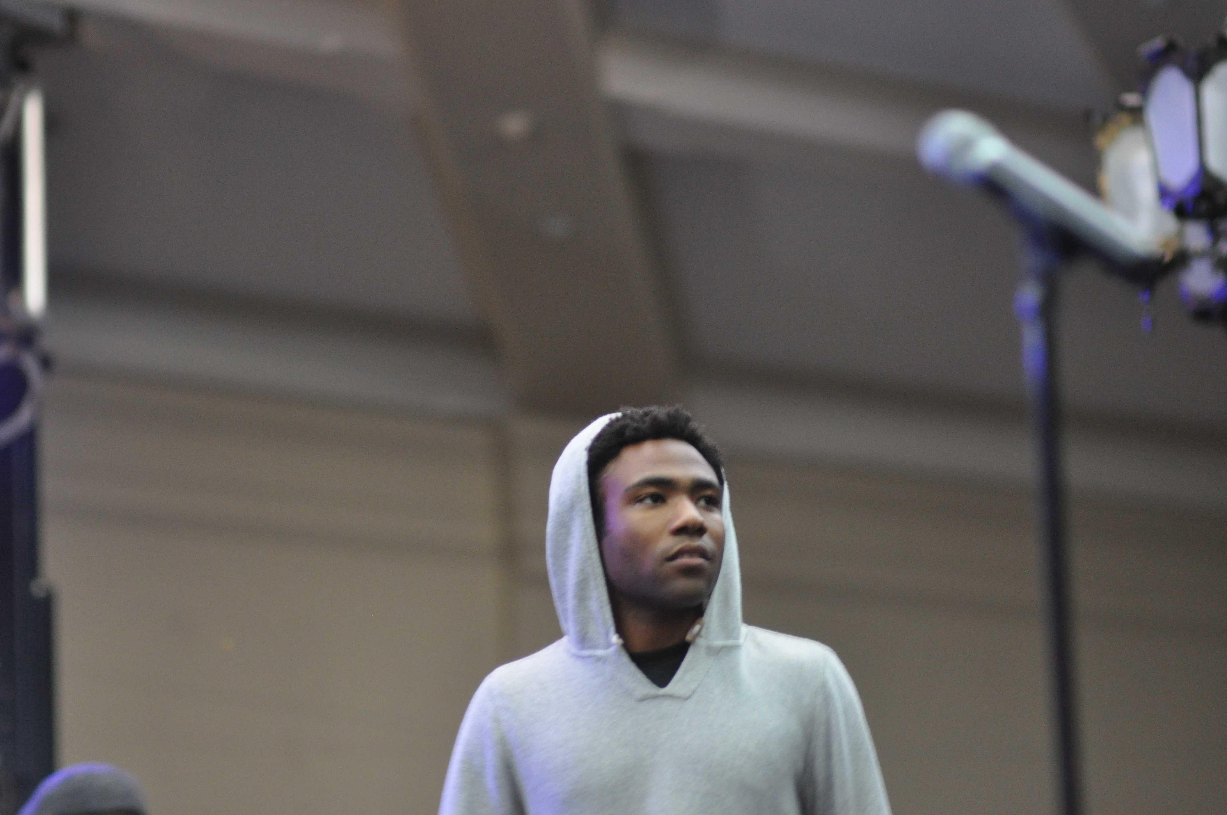 Donald Glover AKA Childish Gambino slowly walking on stage.