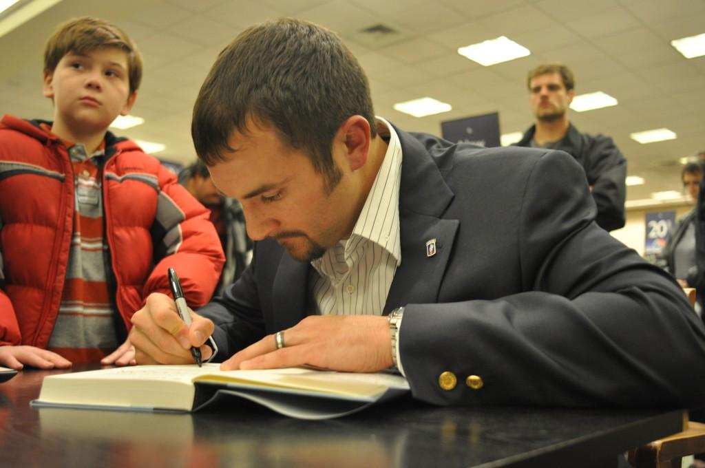 Sal Giunta signs copies of his books to those who came out to Barnes & Nobles to hear him speak.