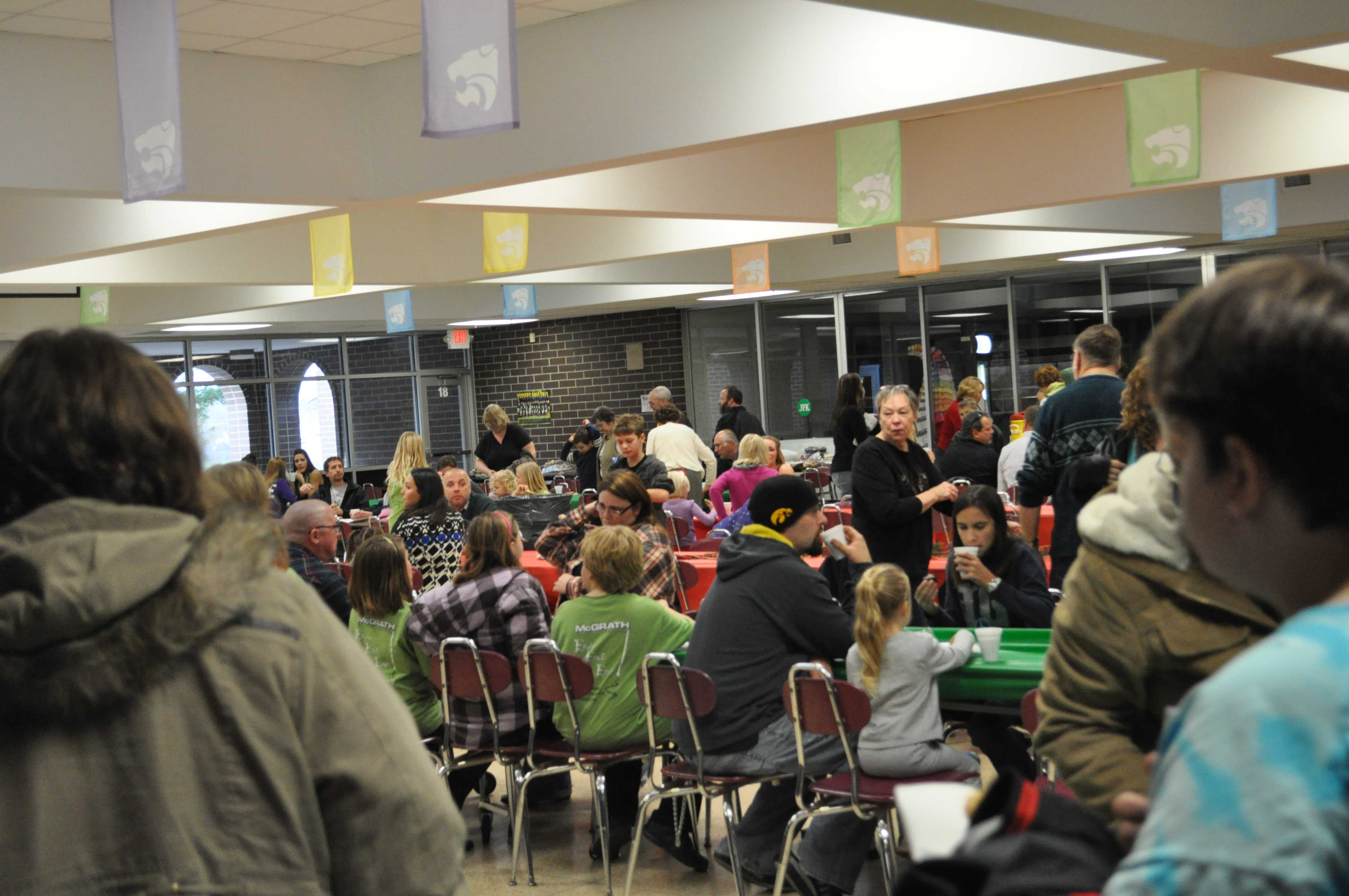 Students and their families enjoy cookies and cocoa at Cocoa and Carols.