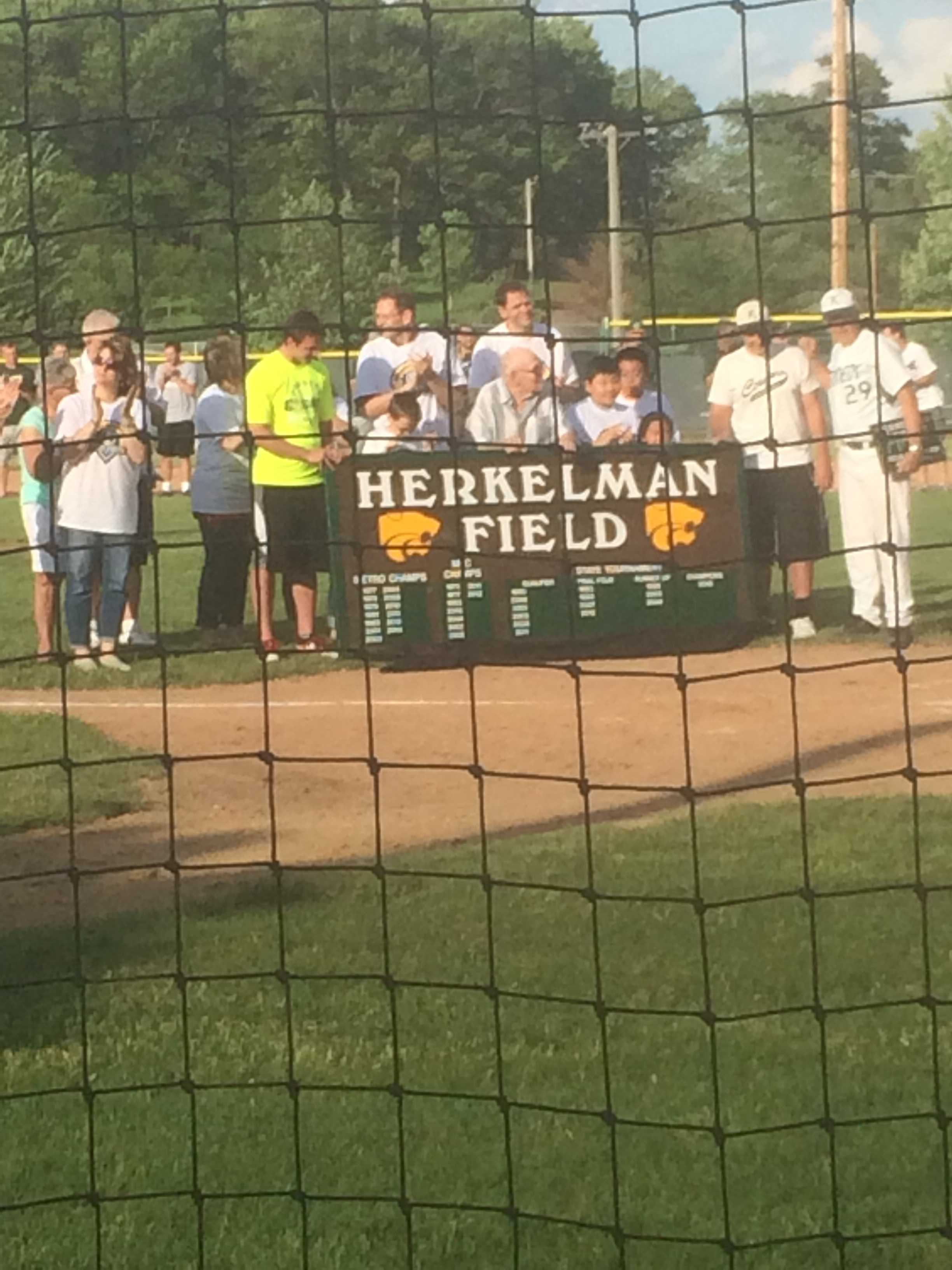 Coach Bill Herkelman and family honored with the naming of field.