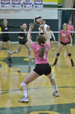 Kennedy volleyball plays Iowa City West in Dig Pink event