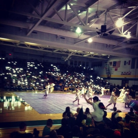 Kennedy winter guard performs at the winter pep assembly.