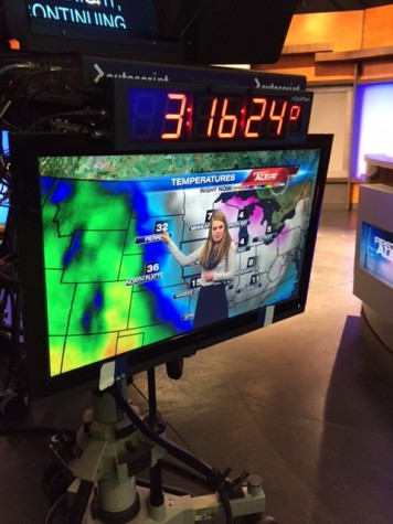 Junior Abby Donovan tries out her meteorology and broadcasting skills at KCRG-TV 9 studios.
