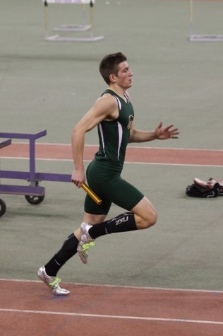 Hunter Schoenauer, sr., sprints in his leg of the relay. Photo by Lori Schoenauer.