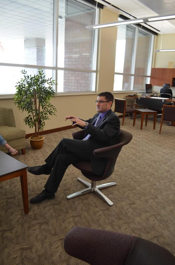 Dr. Brad Buck talks with Torch reporters April 3 at the superintendents office at the Cedar Rapids Educational Service Learning Center.