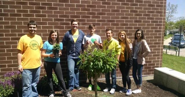 Students plant cancer memorial gardens.