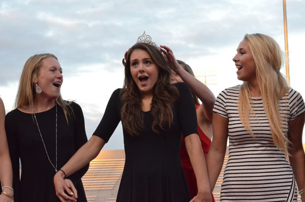 Senior Ellie Klein is crowned homecoming queen with enthusiastic support from her fellow homecoming court members.