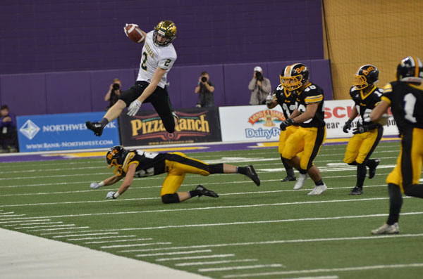 Shaun Beyer, sr., hurdles an opponent, gaining major yards at the semi-final game.