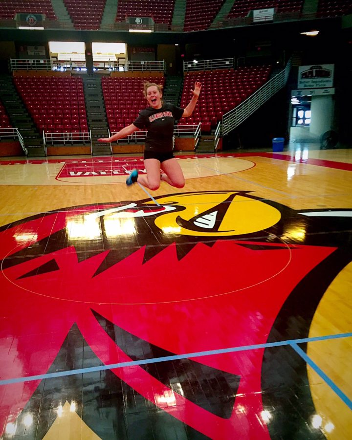 Jumping in the air after Kendal committed to playing volleyball at Illinois State University