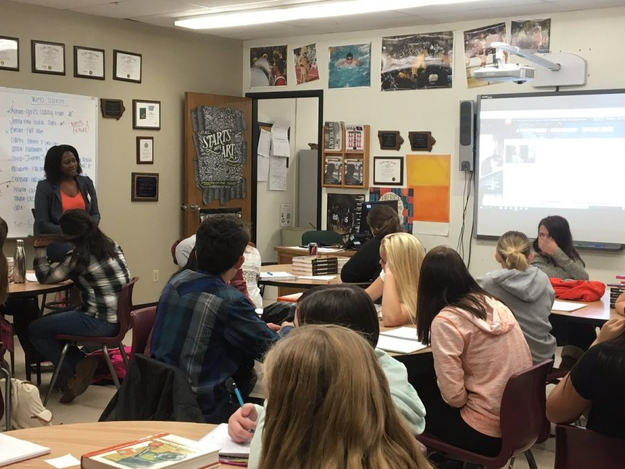 Communications specialist Meryn Fluker speaks with Introduction to Media students Oct. 14, offering advice and ideas for writing and journalism careers.