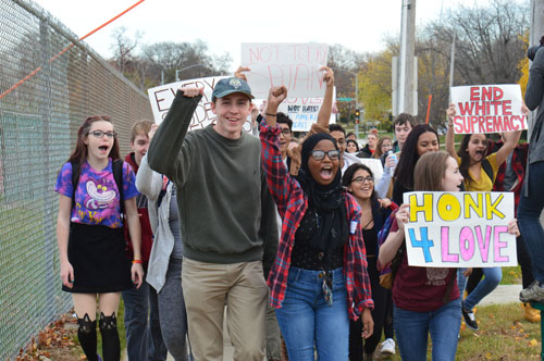 More than 50 students took part in the protest. Seniors Donovan Screws (left) and Afnan Elsheikh (right) joined the walkout.