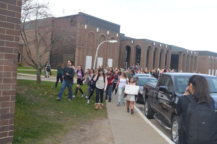 Kennedy students start the protest outside the horseshoe. Administration quickly met them giving out guidelines and explaining their rights.