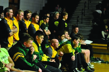 Mallicoat and the team watch the anchor match in the 49-24 win over Jefferson. This was Mallicoat's first meet as the head coach.