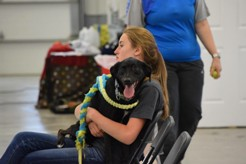 Natalie McAllister, jr., waits with one of her three dogs that she trains for competitions.
