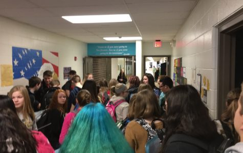 Students pass through the social studies hallway at Kennedy during the