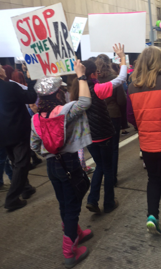 An 8-year-old girl protests in Pittsburgh showing her support for women's rights.