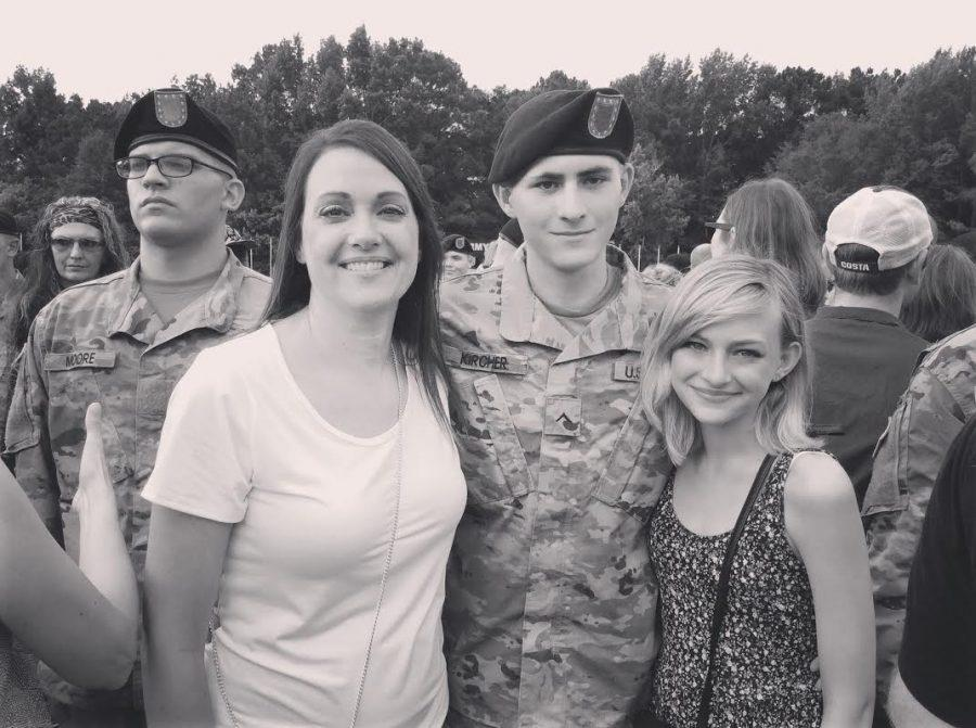 Left to Right: Sarah Kircher, Micheal Kircher, and Mady Kircher at Mic's graduation ceremony for Basic Training.