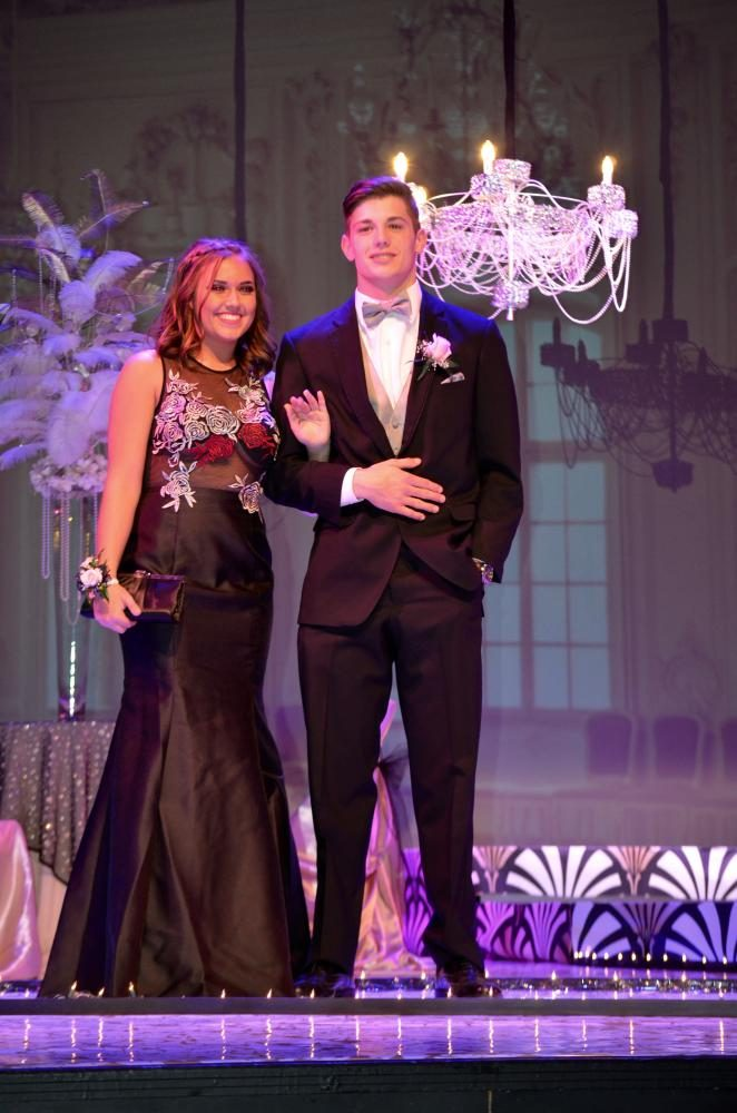 Brooke Bekeris sr., and Hunter Erickson sr., smile big at the grand march.
