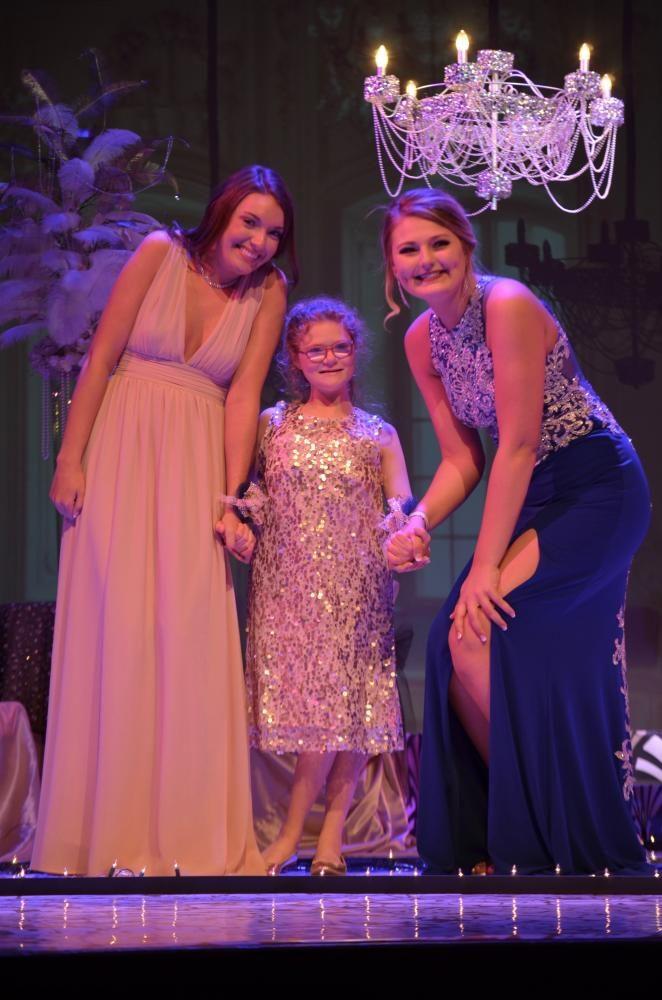 Aubrey Langhurst sr.,and Kelsey Whitmore sr., take Ellie Grovert jr., to her first ever prom.