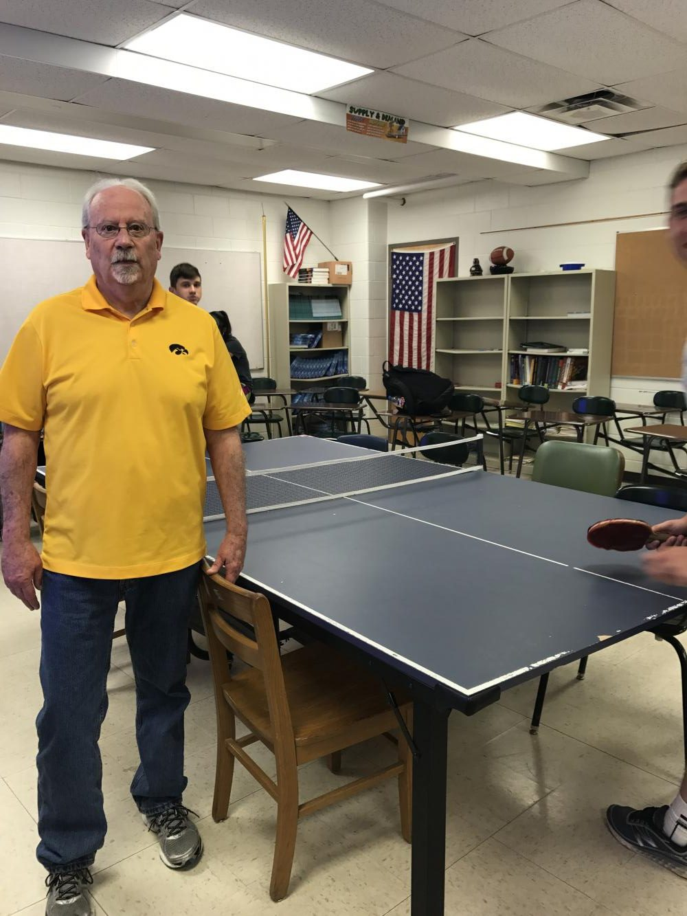 Pat Grady hanging out during Smart Time while students play ping pong in his room. Photo by Anna Reinhart.
