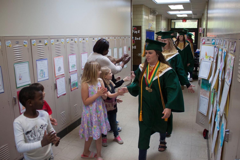 Karlynn Fifield, sr., walking down the halls of Hiawathia Elementary School, shaking hands of third graders.
