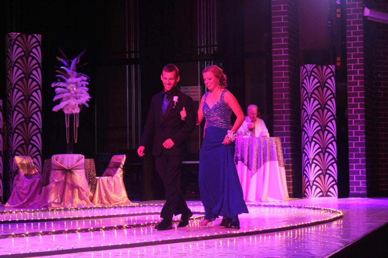 Destiny Cottrell sr., and Payton McCarty sr., share a lovely laugh at grand march.