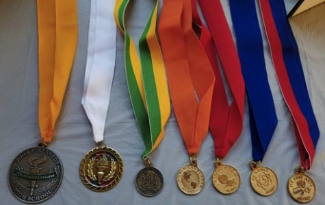 Medals. Ashlynn laid out her graduation medals on a table in her sun porch for guests to view.