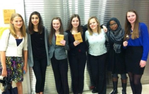 Debate Team members pose for a photo after their competition.