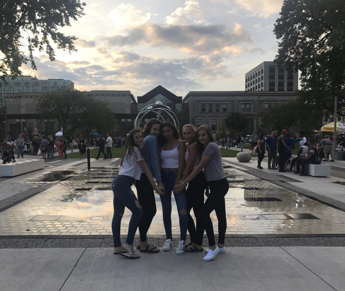 Sophomores Hannah Wieland, Katie Jensen, Olivia Damico, Alexis McQuistion, and Rose Svatek pose for a photo at Greene Square Park.