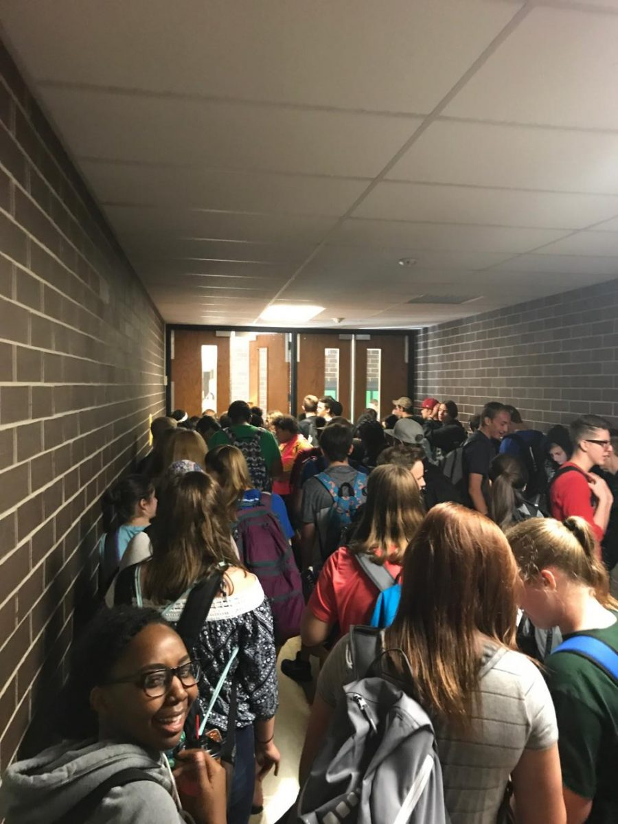 Crowd of students waiting to be released from the cafeteria.