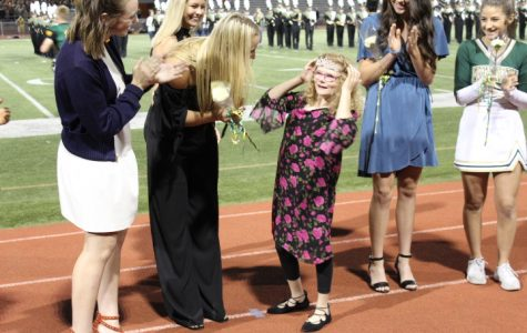 Ellie Grovert crowned by previous homecoming queen Macy Schares.
