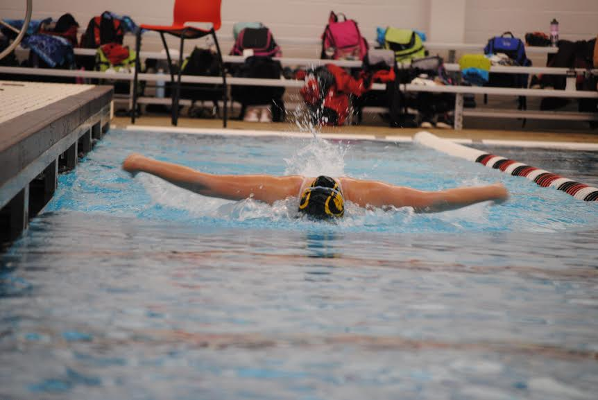 Tori Thorne jr., warming up at regionals, practicing Butterfly.