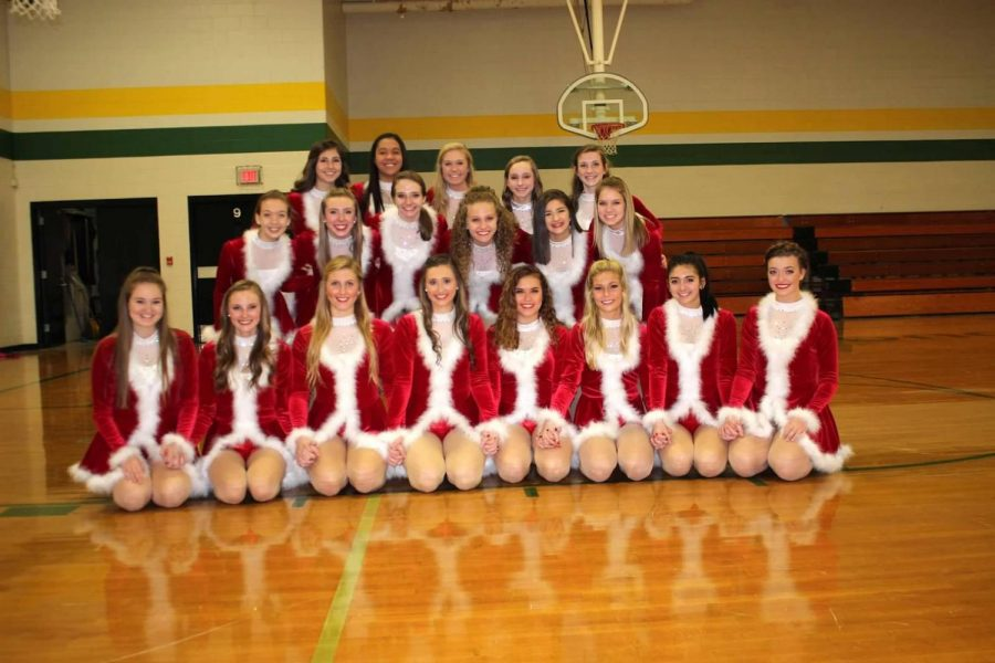 The varsity dance team poses before their Christmas Kick performance last December.