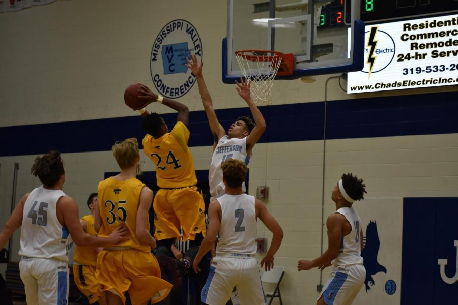 Derek Diggins, sr., catching air for two points.