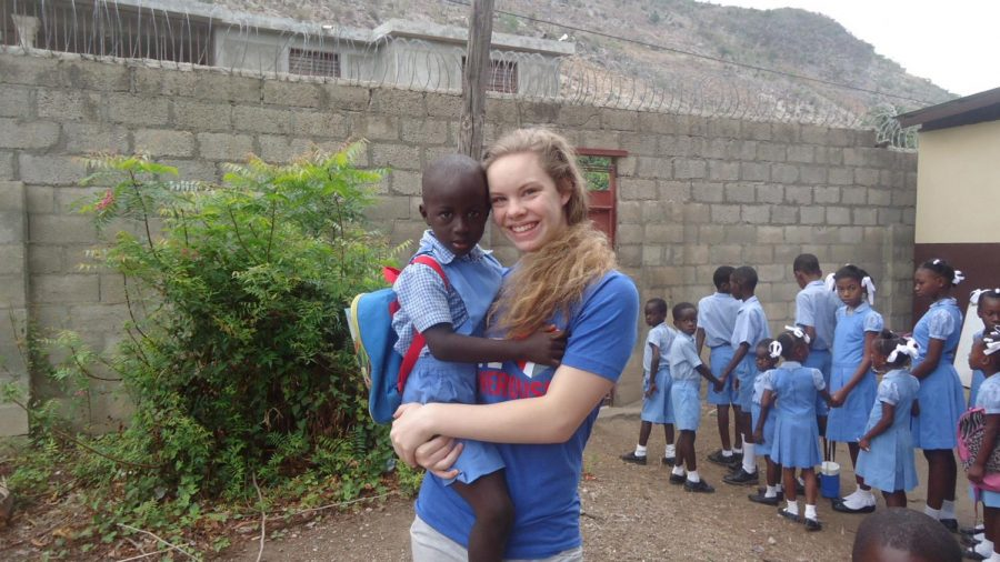 Vander+Sanden+with+Makendy%2C+an+orphan+from+Haiti+where+she+did+mission+work.+