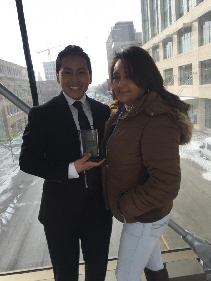 Joes Juarez and his mother after receiving the award