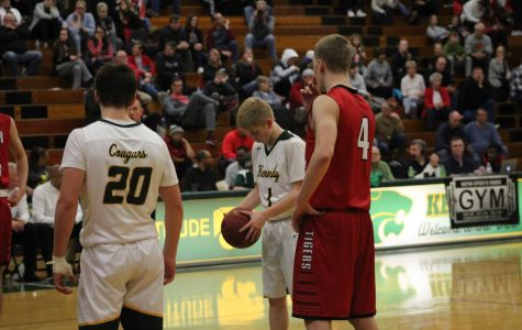 Jackson Foley, sr., at the line to shoot a free throw.