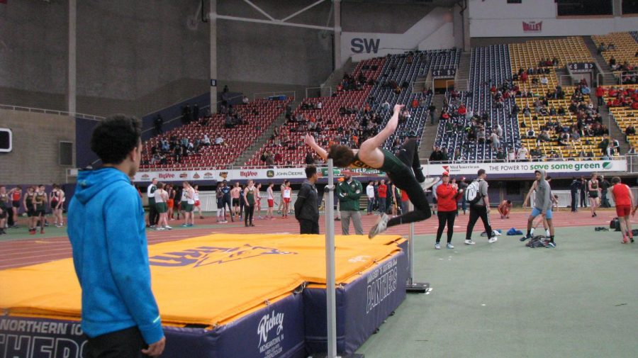 Logan levendusky fr., jumping over the beam for his high jump height.