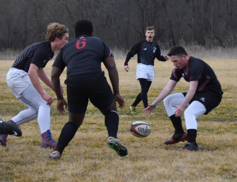 Christian Sackett scrambles to the ball before an opposing player gets it.