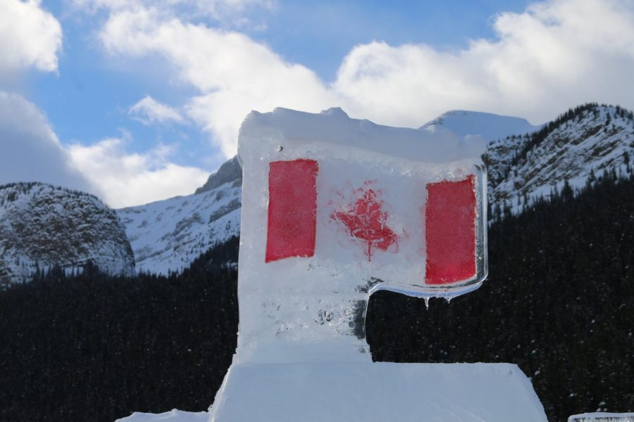 The+first+stop+my+parents+and+I+made+in+the+Banff+area+was+Lake+Louise.+This+flag+was+on+top+of+an+ice+castle+built+on+the+lake+in+front+of+the+Fairmont+Chateau.