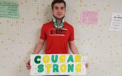 Dylan Falck holding up a get well sign.