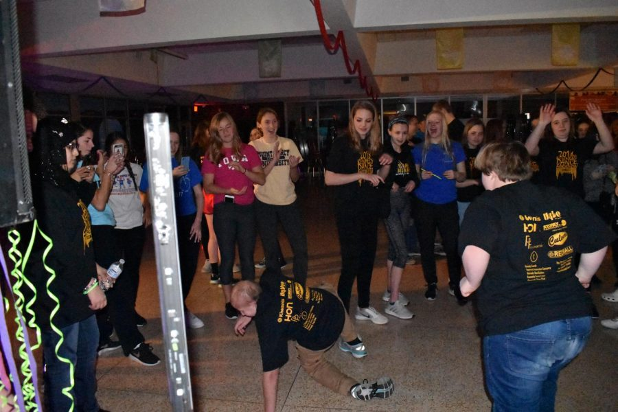The crowd cheering on Jack Hoeger, jr., during his break dance scene.