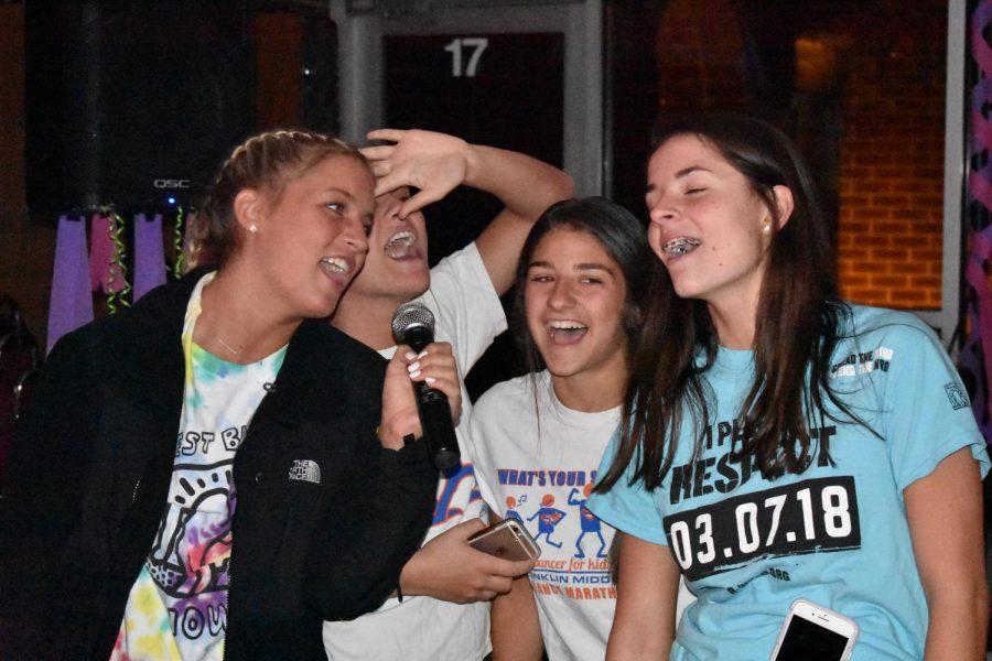 Hannah Maus, jr., Brianna Petsche, sr., Lily Wiese, sr., and Sloane Ferring, so., singing karaoke.