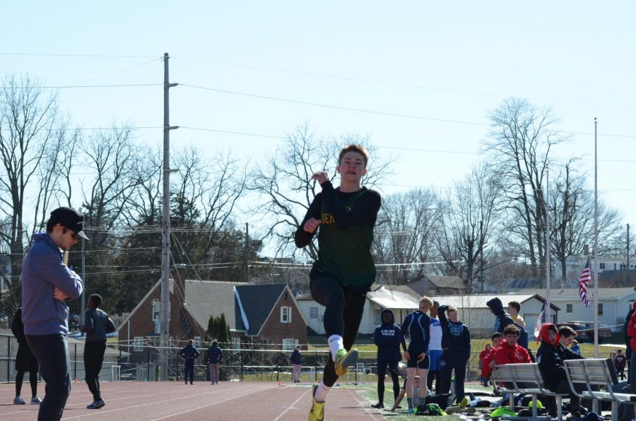 Drew Bartles fr., long jumping into the long jump pit at Dubuque Senior high school.
