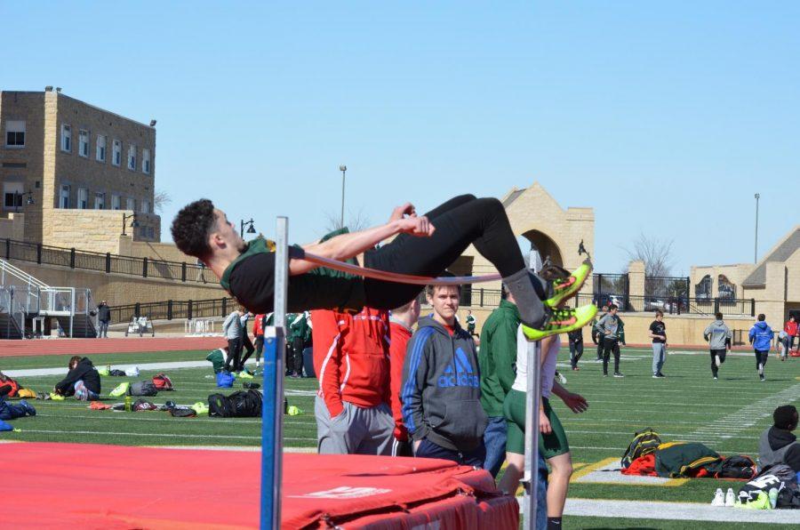 Jaxon Thompson so,. finishing his high jump over the bar.