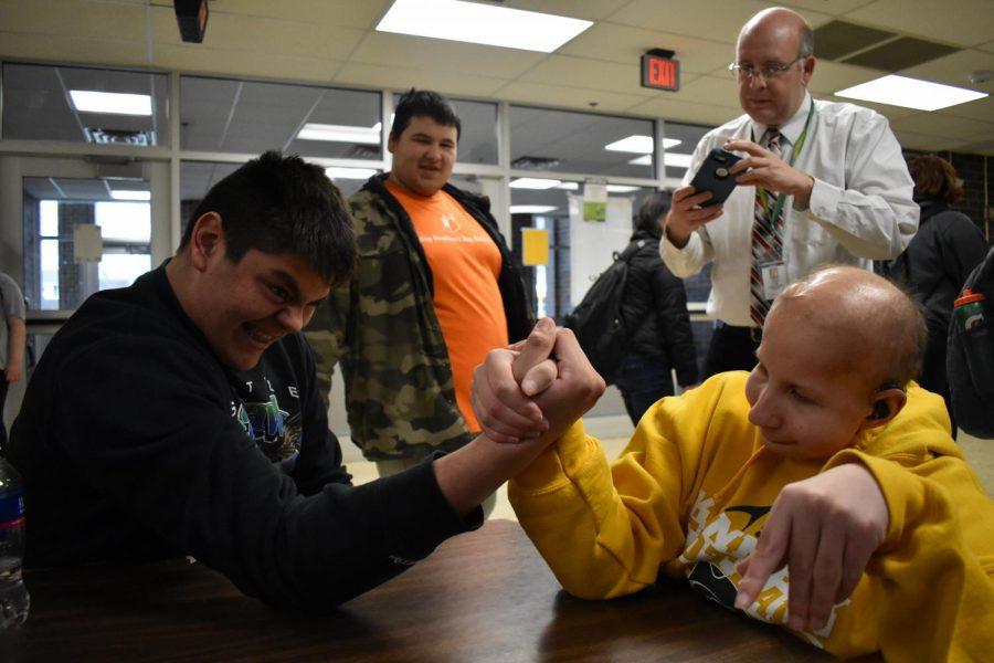 Senior Angel Franco arm wrestling junior Jack Hoeger during SMART Time on April 4.