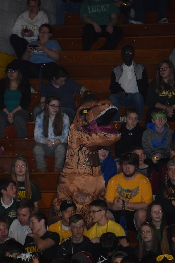 Freshman bring their spirit with a giant T-Rex as a mascot.