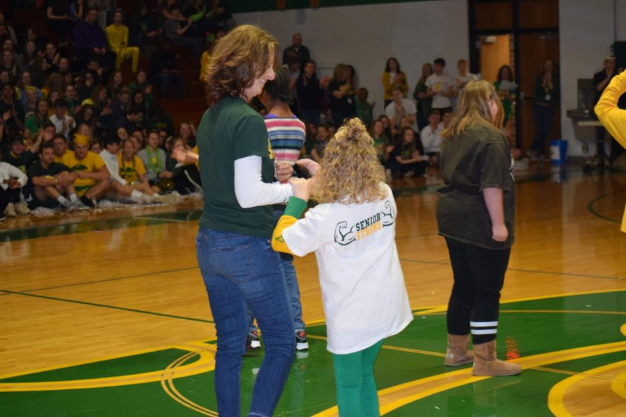 Special Education teacher Mary Gibney and senior Ellie Grovert take center stage with smiles, while Ellie is recognized for being a Special Olympic athlete.
